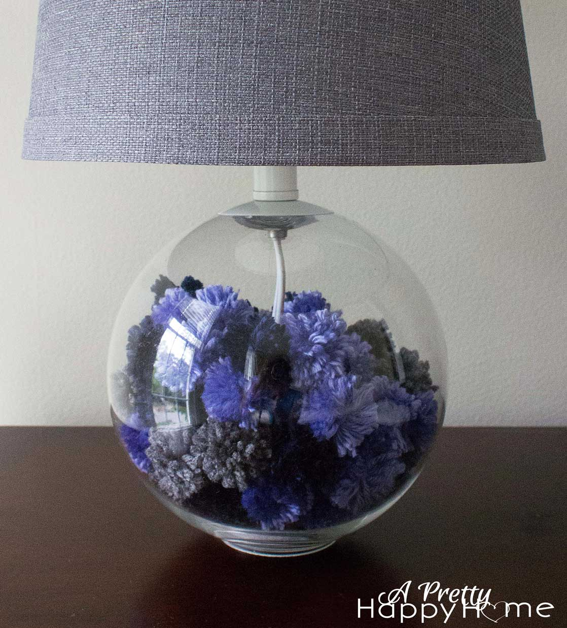 lamp base filled with yarn pom