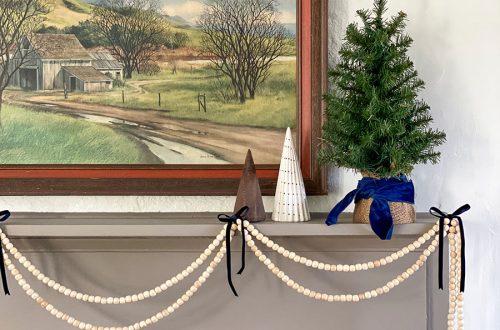 wood bead garland christmas mantel on the happy list