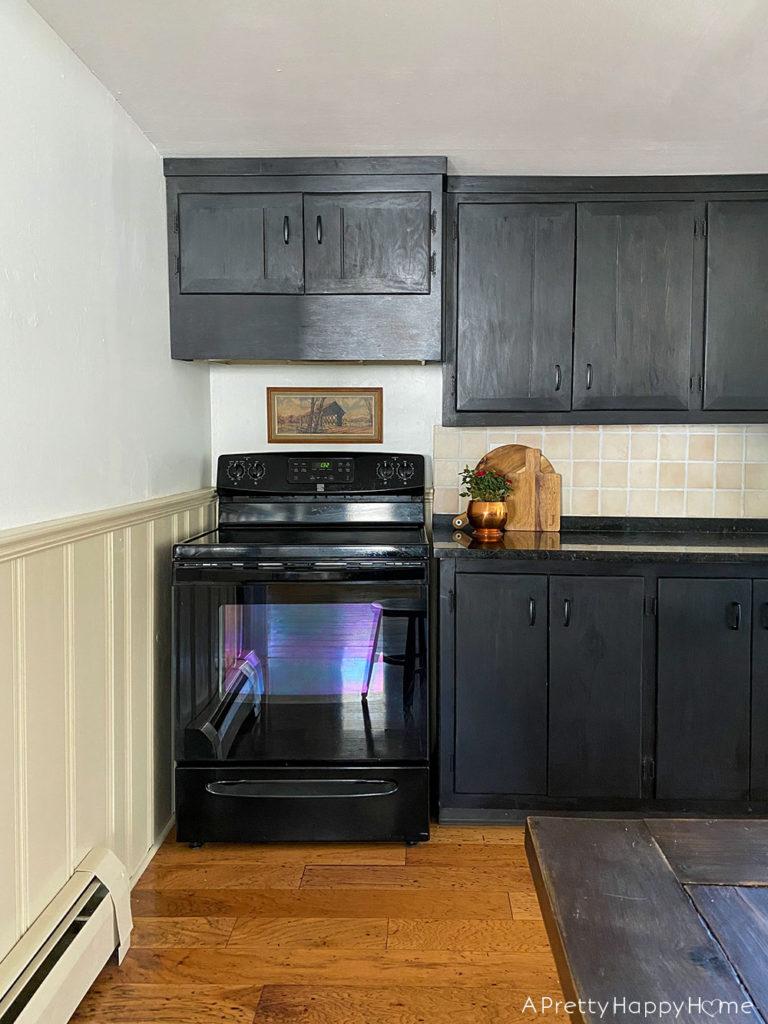 farmhouse black kitchen with landscape art kitchen art