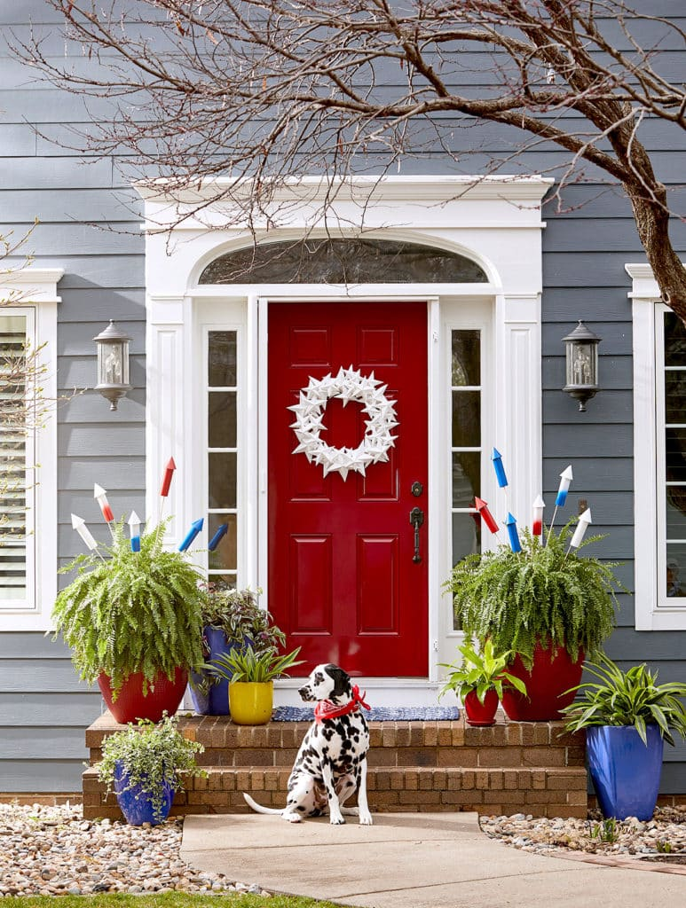 photo credit jacob fox for BHG red door with white wreath on the happy list